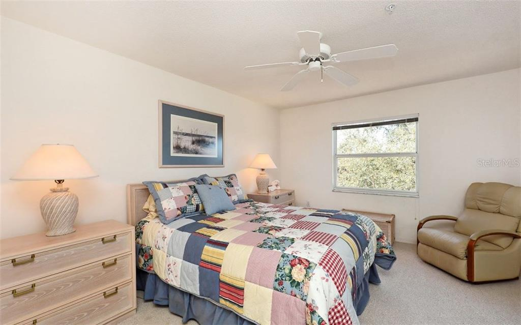 Master bedroom has a slider to the lanai. - Condo for sale at 8750 Olde Hickory Ave #9305, Sarasota, FL 34238 - MLS Number is A4178271