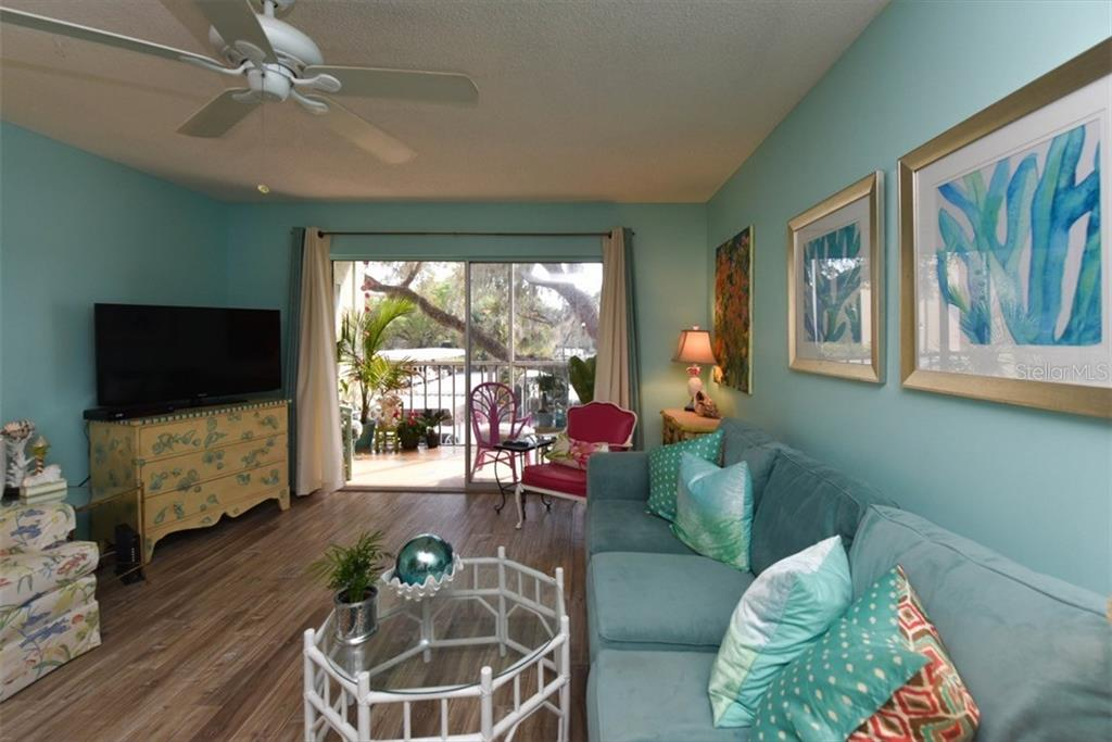 Great Room overlooking lanai. - Condo for sale at 1330 Glen Oaks Dr E #275d, Sarasota, FL 34232 - MLS Number is A4178649