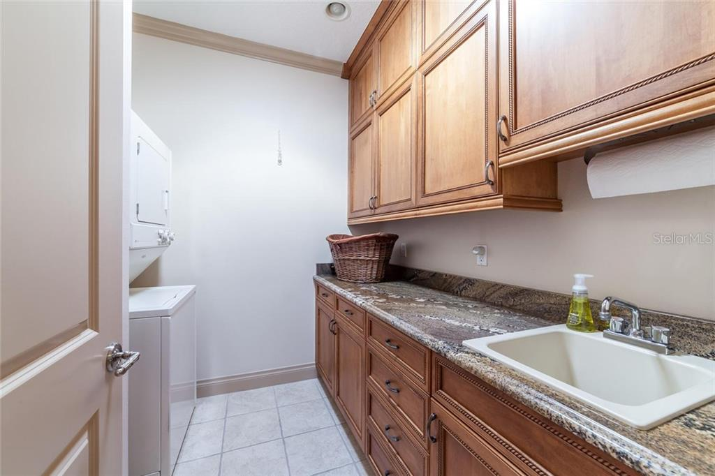 The office space features built in cabinetry and partner's desk with beautiful custom French doors. - Condo for sale at 318 Bay Dr S #7, Bradenton Beach, FL 34217 - MLS Number is A4178742