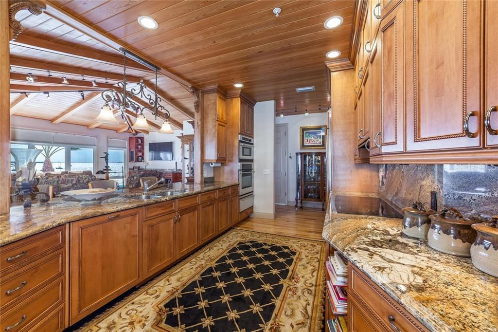 Custom designed, hand built cabinetry in the kitchen. - Single Family Home for sale at 318 Bay Dr S #7, Bradenton Beach, FL 34217 - MLS Number is A4178742