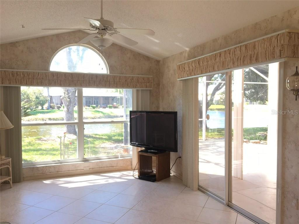 SUNNY DEN WITH VIEW OF LAKE - Single Family Home for sale at 1203 Harbor Town Way, Venice, FL 34292 - MLS Number is A4180060