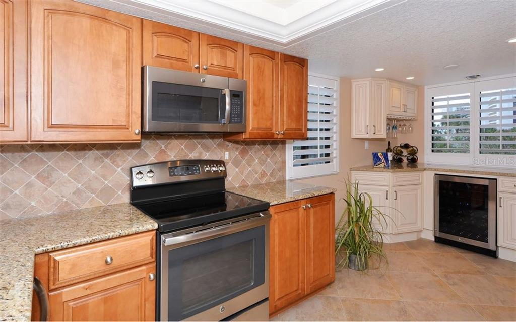 Kitchen with stainless steel appliances - Condo for sale at 6263 Midnight Pass Rd #101, Sarasota, FL 34242 - MLS Number is A4182245