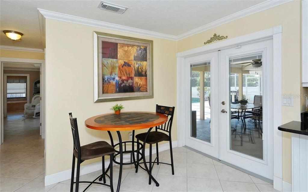 French doors that lead to the lanai. - Single Family Home for sale at 6239 Hollywood Blvd, Sarasota, FL 34231 - MLS Number is A4182790
