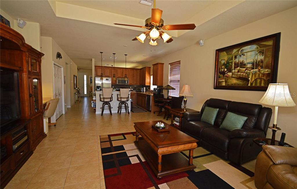 Kitchen, Family Room - Single Family Home for sale at 9006 Heritage Sound Dr, Bradenton, FL 34212 - MLS Number is A4183771