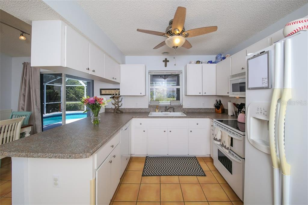 Single Family Home for sale at 7523 42nd Ct E, Sarasota, FL 34243 - MLS Number is A4183998