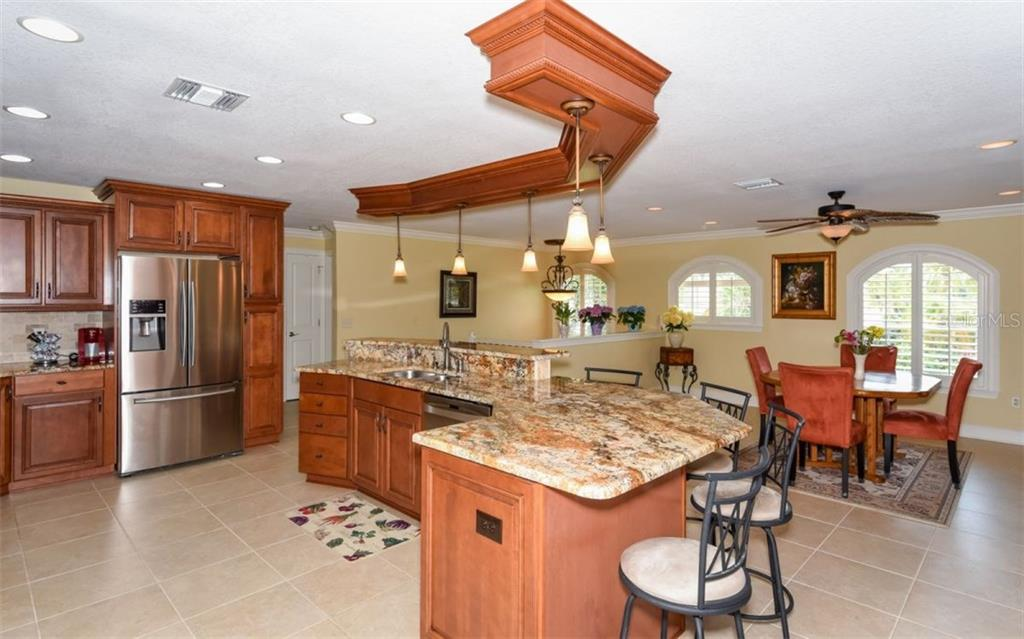 Dining areas & kitchen. - Single Family Home for sale at 1627 Shelburne Ln, Sarasota, FL 34231 - MLS Number is A4184556