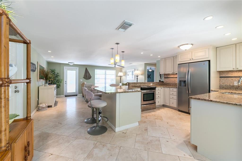Continuous Travertine Tile runs through the entire home. - Single Family Home for sale at 413 Bay Palms Dr, Holmes Beach, FL 34217 - MLS Number is A4184679