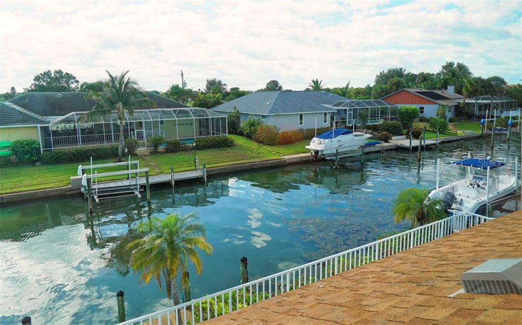 Single Family Home for sale at 620 N Point Dr, Holmes Beach, FL 34217 - MLS Number is A4184866