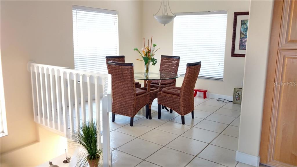 Dining room with lots of natural light - Condo for sale at 9209 Midnight Pass Rd #5, Sarasota, FL 34242 - MLS Number is A4185067