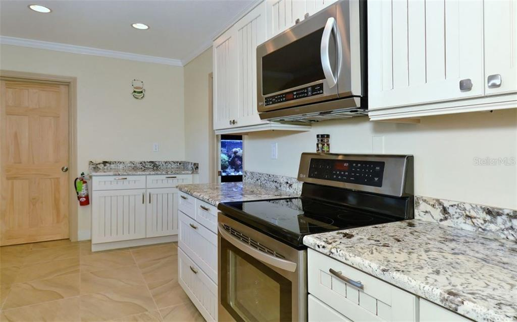 Clubhouse kitchen - Condo for sale at 9397 Midnight Pass Rd #403, Sarasota, FL 34242 - MLS Number is A4185842