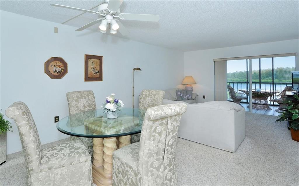 Living/Dining room with sliders to balcony - Condo for sale at 9397 Midnight Pass Rd #403, Sarasota, FL 34242 - MLS Number is A4185842