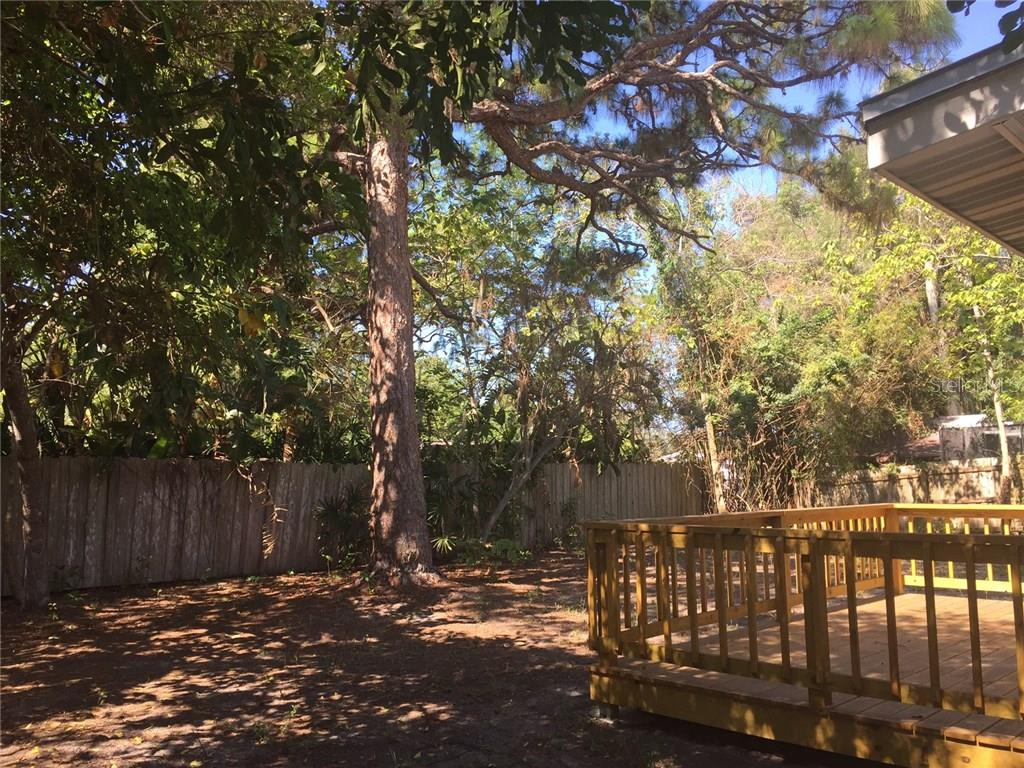 Mature trees shade the property. - Single Family Home for sale at 938 Highland St, Sarasota, FL 34234 - MLS Number is A4186423