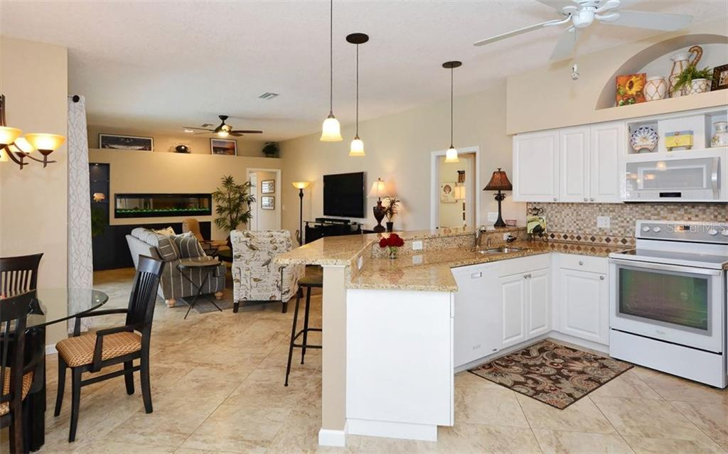 Open Kitchen, family room and breakfast area - Single Family Home for sale at 4121 Via Mirada, Sarasota, FL 34238 - MLS Number is A4186485