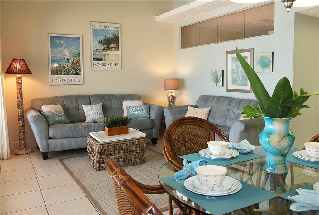 Living Area with cathedral ceilings - Condo for sale at 4621 Gulf Of Mexico Dr #11c, Longboat Key, FL 34228 - MLS Number is A4187979