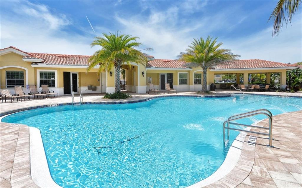 Community swimming pool and clubhouse - Condo for sale at 81 Navigation Cir #103, Osprey, FL 34229 - MLS Number is A4188370