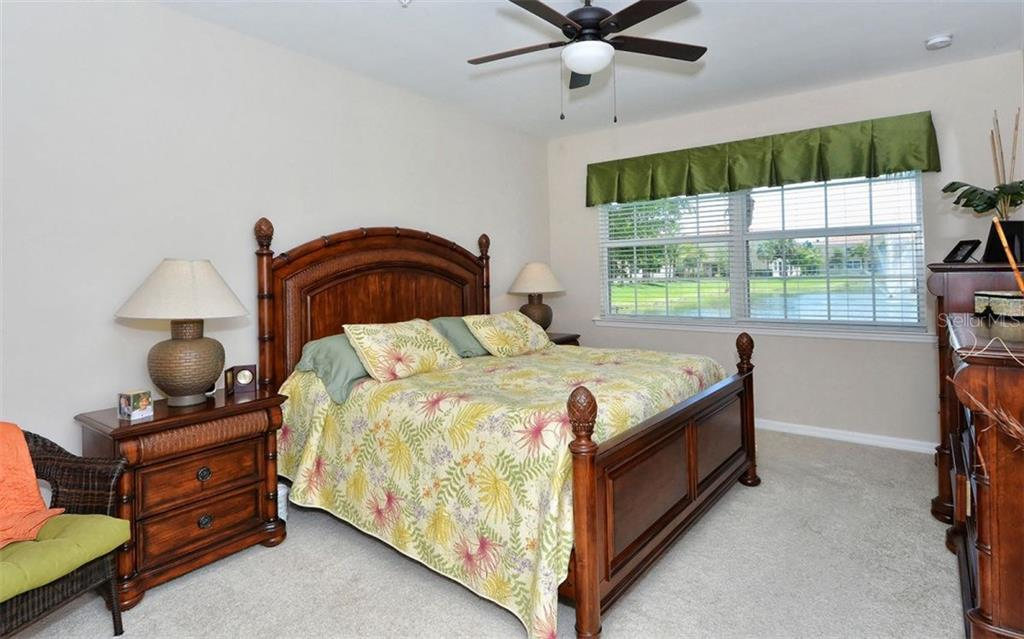 Master bedroom with lake views - Condo for sale at 81 Navigation Cir #103, Osprey, FL 34229 - MLS Number is A4188370