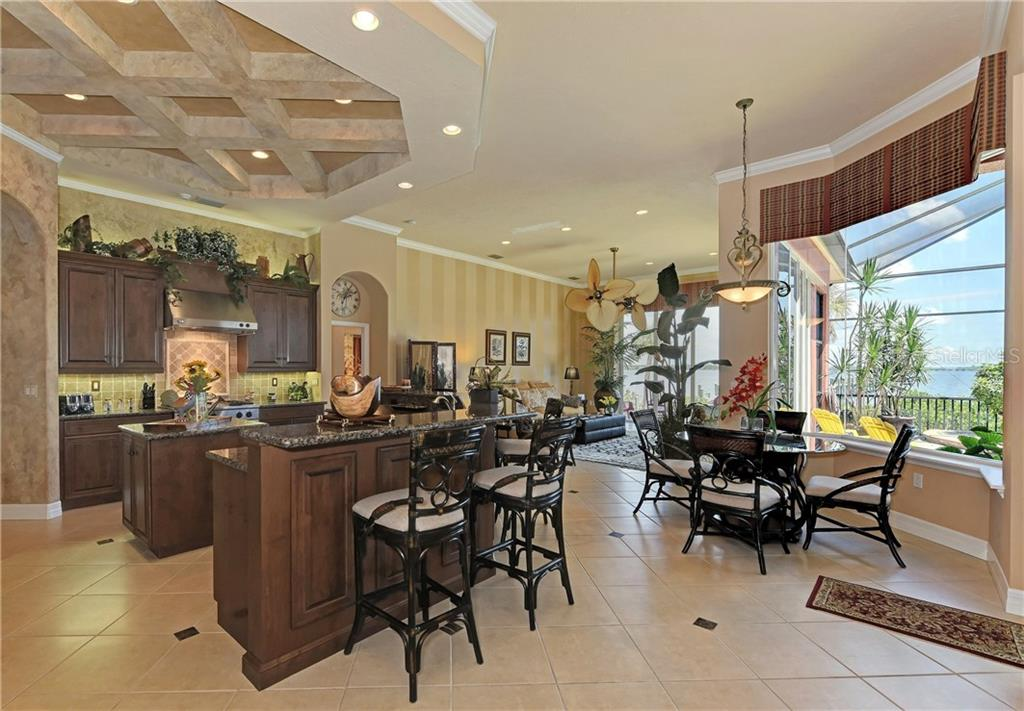 Counter top bar and Breakfast Nook, open to Family Room - Single Family Home for sale at 370 Highland Shores Dr, Ellenton, FL 34222 - MLS Number is A4188456