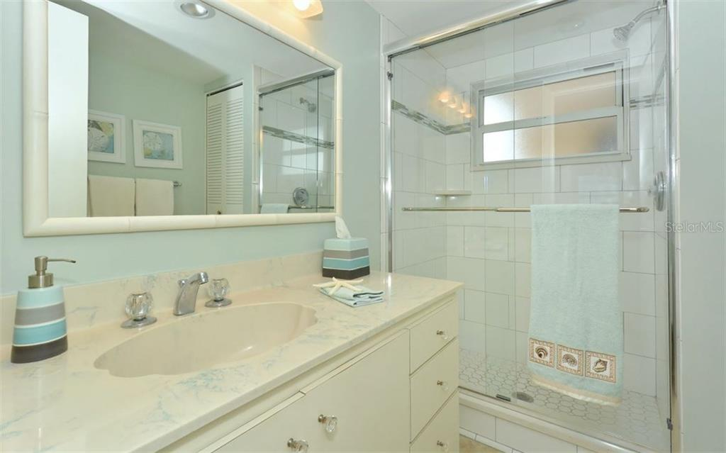 Master bathroom with walk-in shower - Condo for sale at 6300 Midnight Pass Rd #806, Sarasota, FL 34242 - MLS Number is A4189340