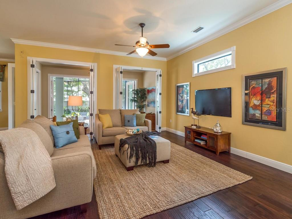 Welcoming family room with beautiful clerestory window adds natural light along with glass paneled doors to bonus sun room. - Single Family Home for sale at 1884 Grove St, Sarasota, FL 34239 - MLS Number is A4189365