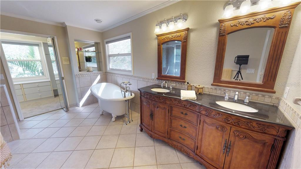 The large master bath with double sinks, a separate shower, water closet and through to the large, light filled, well appointed master closet - Single Family Home for sale at 9122 16th Avenue Cir Nw, Bradenton, FL 34209 - MLS Number is A4189396
