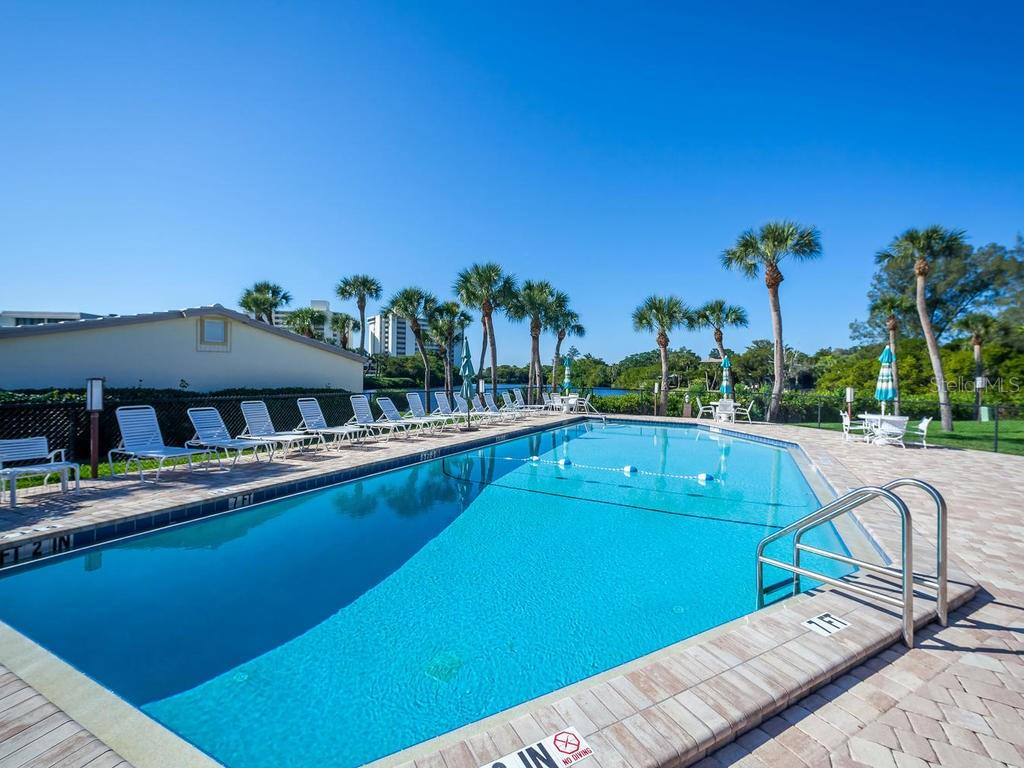 Community clubhouse swimming pool - Condo for sale at 19 Whispering Sands Dr #205, Sarasota, FL 34242 - MLS Number is A4189914