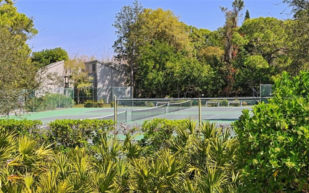 Tennis courts, some also marked for pickle ball - Condo for sale at 104 Woodland Pl #104, Osprey, FL 34229 - MLS Number is A4190676