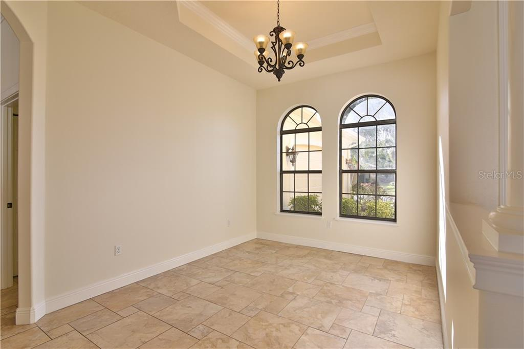 Lovely Dining Room - Single Family Home for sale at 7662 Trillium Blvd, Sarasota, FL 34241 - MLS Number is A4190704