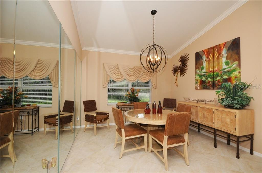 Dining room - Villa for sale at 7707 Calle Facil, Sarasota, FL 34238 - MLS Number is A4191635