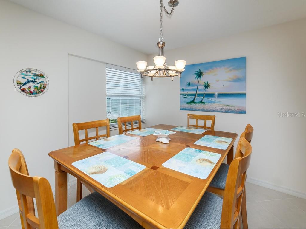 Dining Area with Gulf View from Window - Condo for sale at 1750 Benjamin Franklin Dr #5g, Sarasota, FL 34236 - MLS Number is A4192160