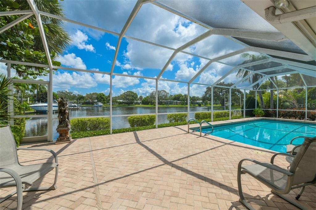Paver brick lanai with canal views - Single Family Home for sale at 5515 Contento Dr, Sarasota, FL 34242 - MLS Number is A4194719