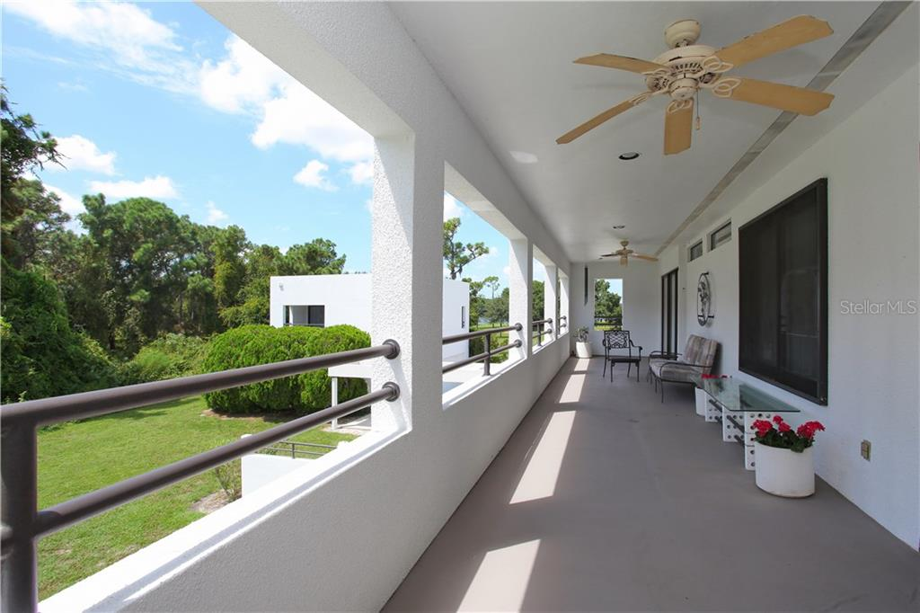 The terrace can be accessed from the owner's suite or from the work space that encourages entrepreneurs to be creative! - Single Family Home for sale at 4831 Hoyer Dr, Sarasota, FL 34241 - MLS Number is A4195351