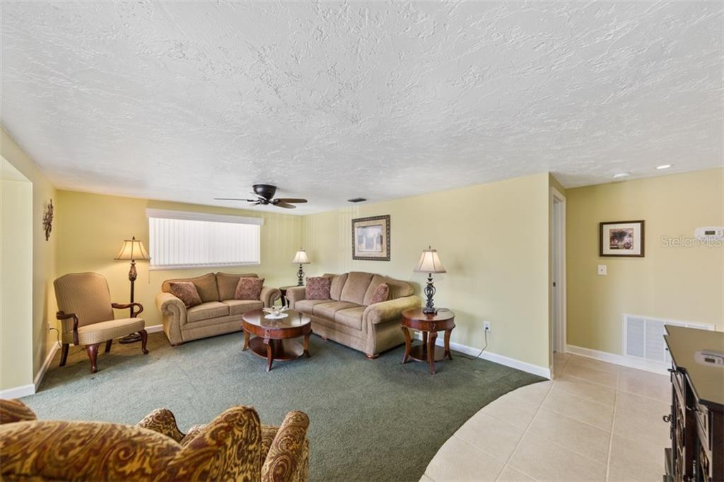 Living room - Condo for sale at 6140 Midnight Pass Rd #c-9, Sarasota, FL 34242 - MLS Number is A4195879