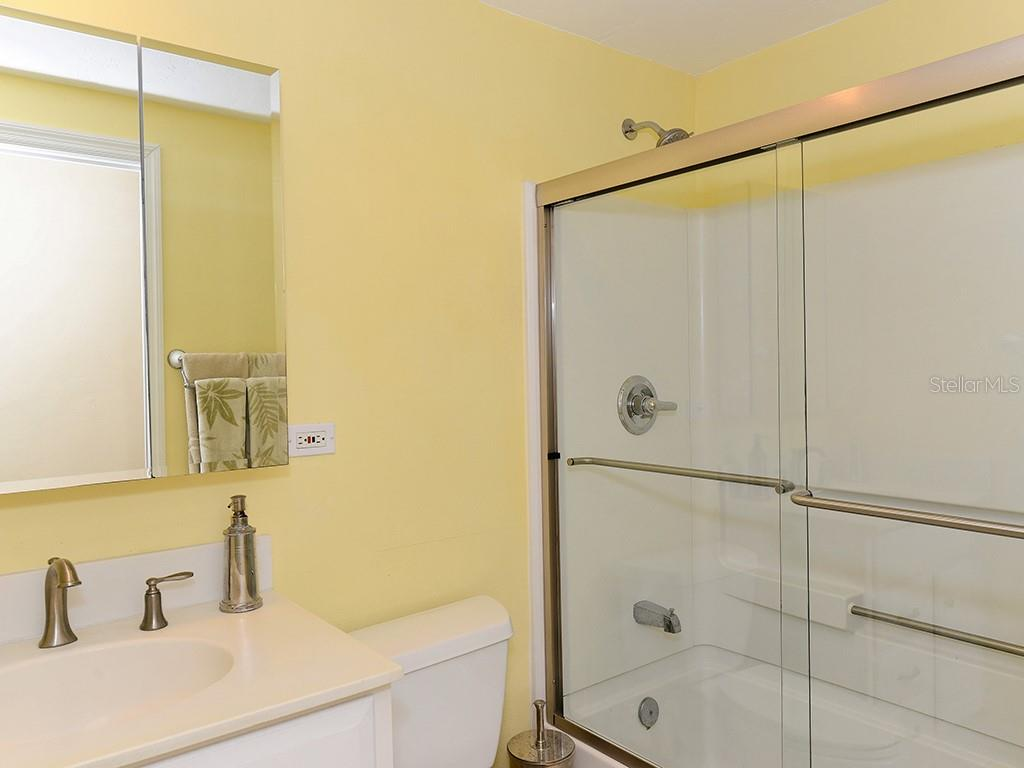 Guest Bathroom - Single Family Home for sale at 726 Jungle Queen Way, Longboat Key, FL 34228 - MLS Number is A4196293