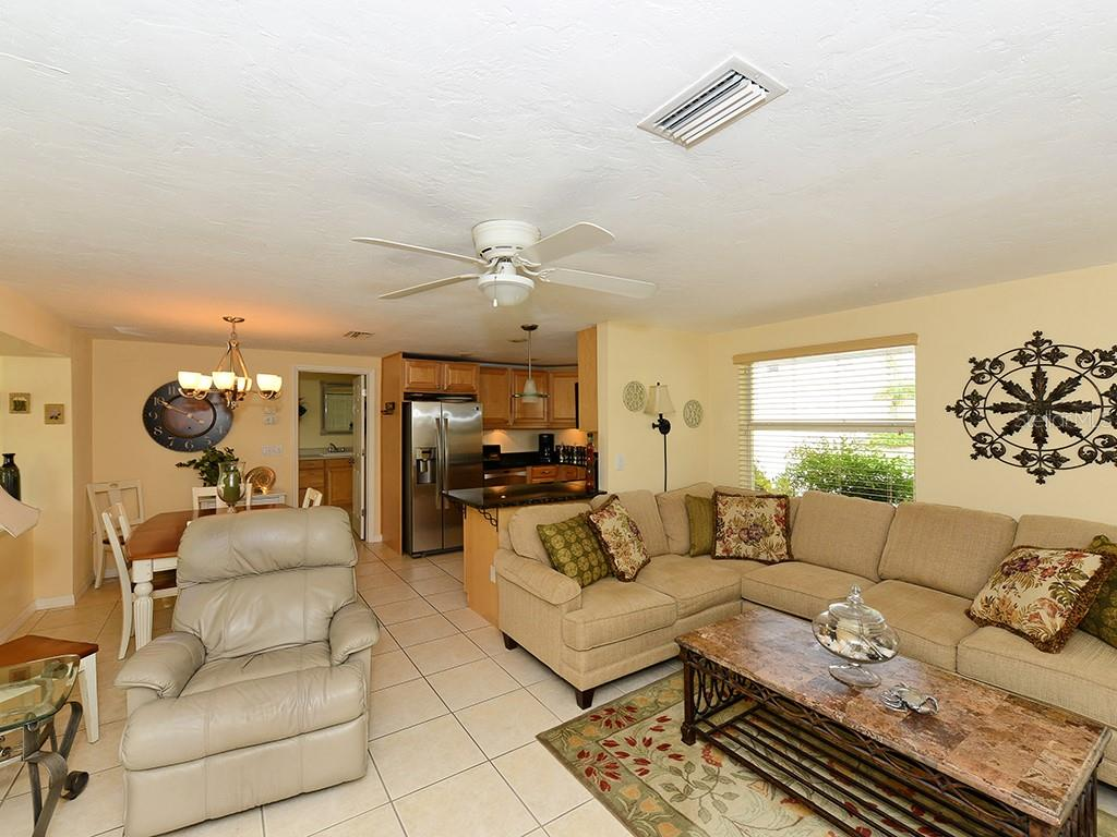 Living and family room - Single Family Home for sale at 726 Jungle Queen Way, Longboat Key, FL 34228 - MLS Number is A4196293