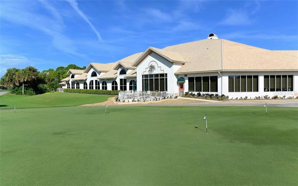 Stoneybrook Golf & Country Club main complex overlooks the practice green and 18th fairway.  There's a full-service restaurant, grill room and banquet rooms; pro shop; admin offices and outside terrace area. - Condo for sale at 9570 High Gate Dr #1712, Sarasota, FL 34238 - MLS Number is A4196327