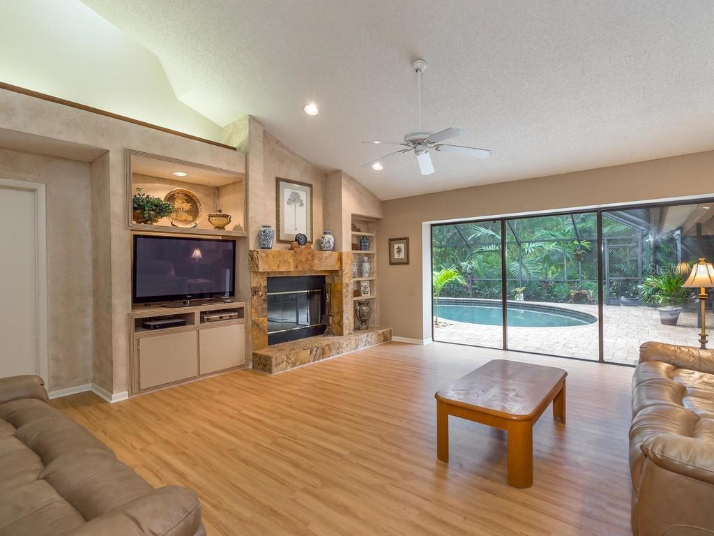 Family with wood burning fireplace - Single Family Home for sale at 7520 Weeping Willow Dr, Sarasota, FL 34241 - MLS Number is A4196497