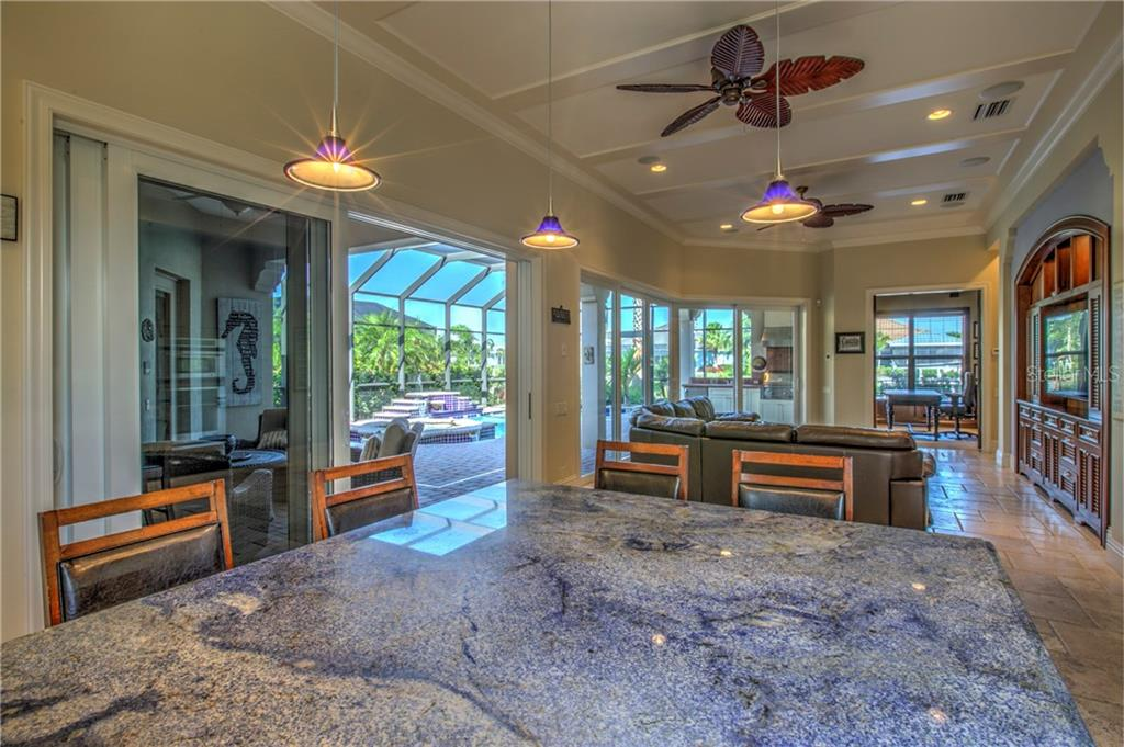 Large kitchen island with counter height seating, makes entertaining a breeze! - Single Family Home for sale at 548 Fore Dr, Bradenton, FL 34208 - MLS Number is A4196590