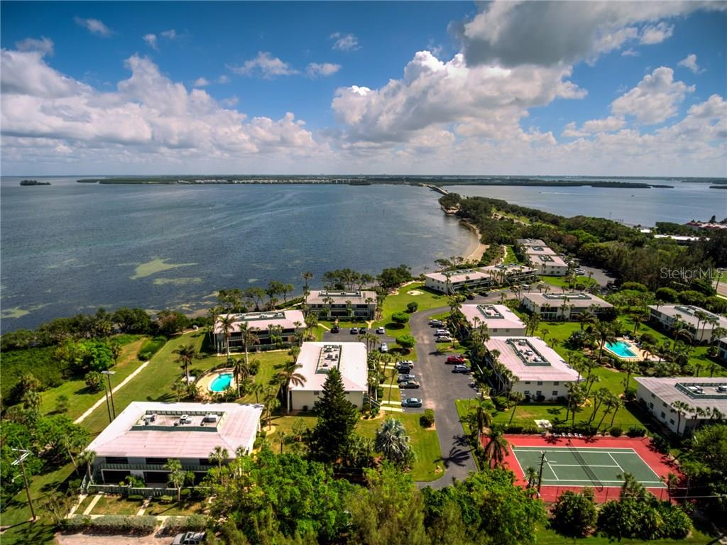 Aerial of the Community with views of the Anna Maria Bridge - Condo for sale at 600 Manatee Ave #236, Holmes Beach, FL 34217 - MLS Number is A4197636