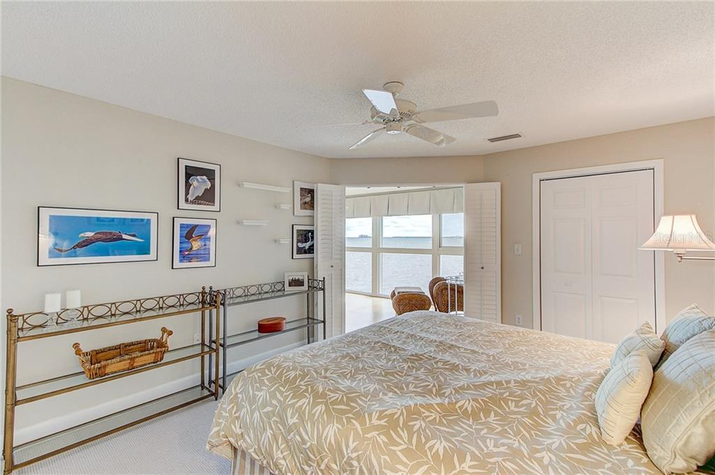 Master Bedroom with large walk in custom closet - Condo for sale at 600 Manatee Ave #236, Holmes Beach, FL 34217 - MLS Number is A4197636