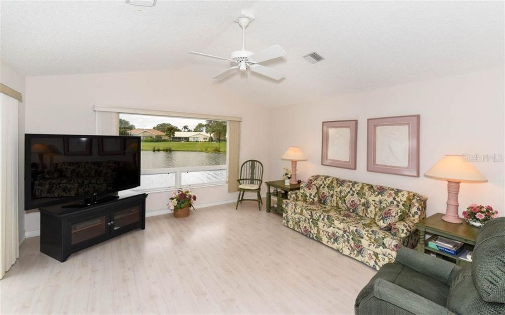Family Room Offers a Large Tinted Picture Window with Spectacular Views - Single Family Home for sale at 1632 Valley Dr, Venice, FL 34292 - MLS Number is A4197771