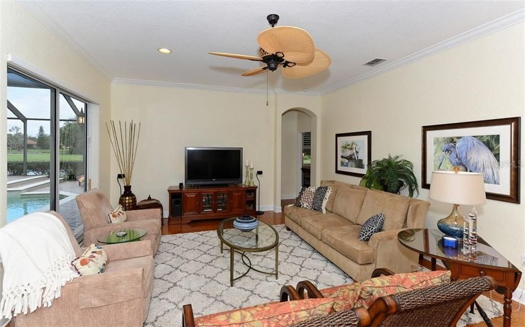 Family Room - Single Family Home for sale at 9919 Portside Ter, Bradenton, FL 34212 - MLS Number is A4197815