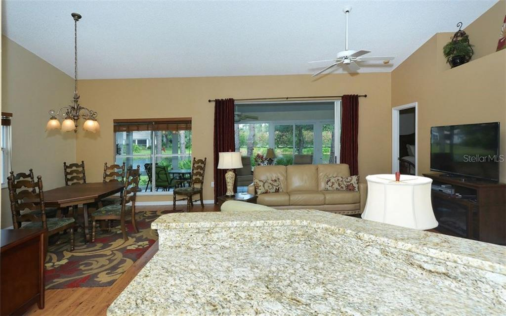 Living area.  Lots of windows. - Single Family Home for sale at 9571 Knightsbridge Cir, Sarasota, FL 34238 - MLS Number is A4197972