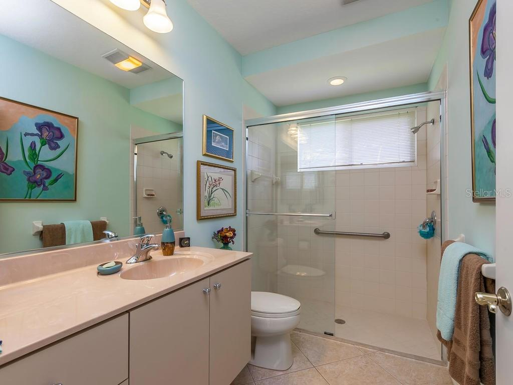 Third bath has access to the pool. - Single Family Home for sale at 4887 Carrington Cir, Sarasota, FL 34243 - MLS Number is A4199511
