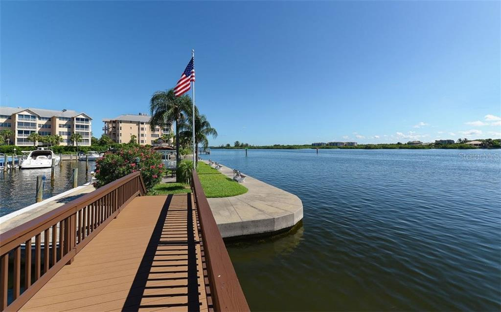 Community bay front and dock - Condo for sale at 5855 Midnight Pass Rd #328, Sarasota, FL 34242 - MLS Number is A4200358