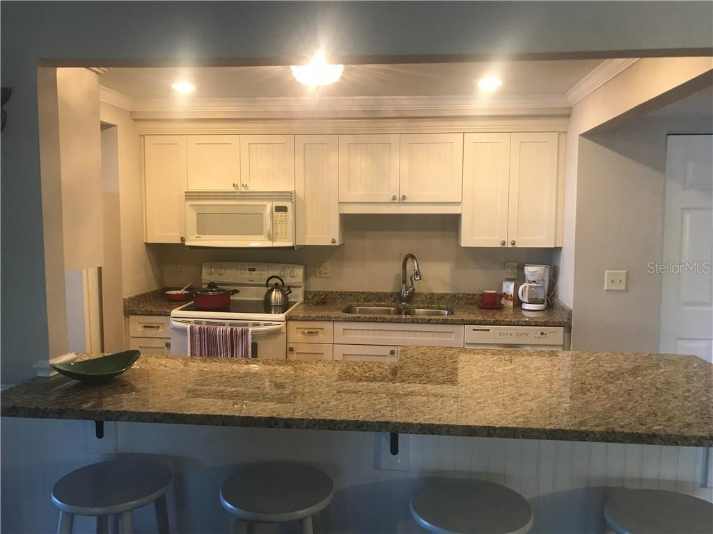 Open Breakfast Bar - Condo for sale at 5855 Midnight Pass Rd #328, Sarasota, FL 34242 - MLS Number is A4200358