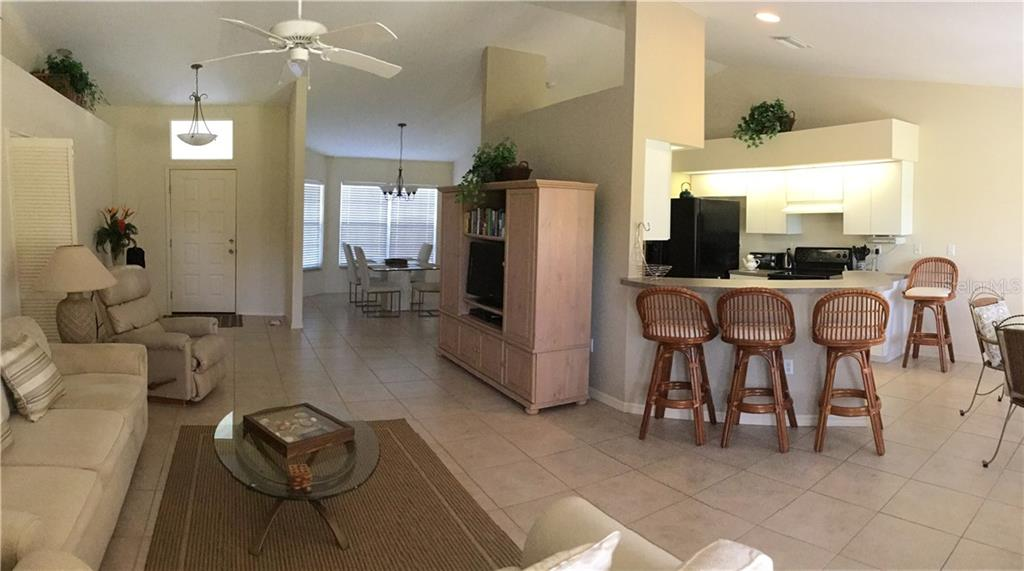Great Room - Kitchen Breakfast Bar - Dining Room - Single Family Home for sale at 6320 Hera St, Englewood, FL 34224 - MLS Number is A4200968