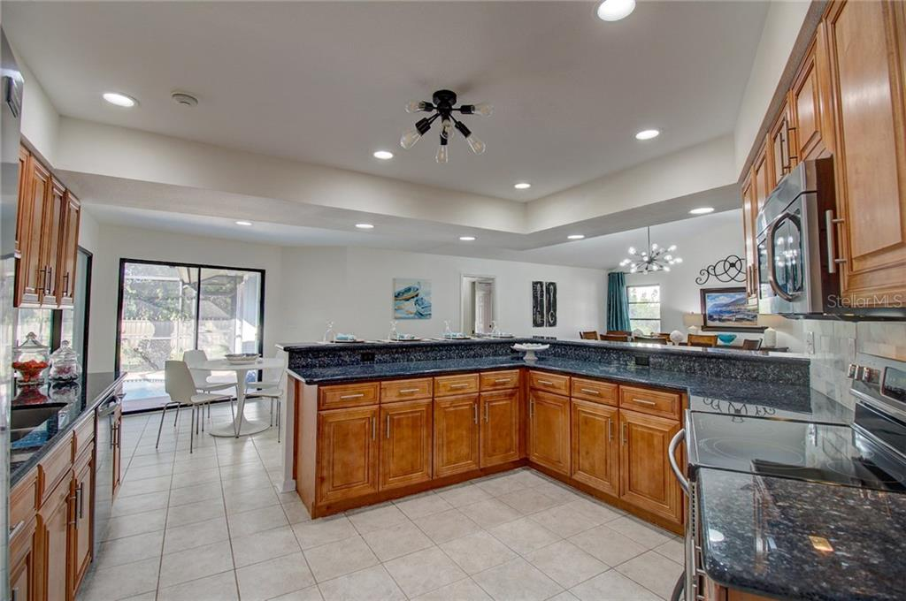 Kitchen Looking towards Breakfast Nook and Pool - Single Family Home for sale at 1087 Hoover Cir, Nokomis, FL 34275 - MLS Number is A4201722