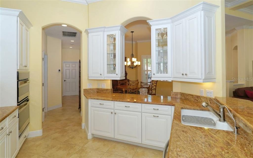 Crisp white cabinetry, plenty of prep space on granite counters - Single Family Home for sale at 1746 Hillview St, Sarasota, FL 34239 - MLS Number is A4202985