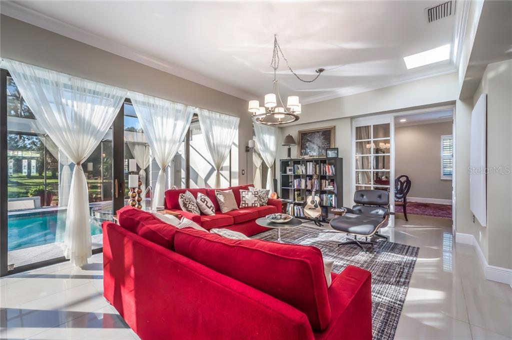 Family Room - Single Family Home for sale at 5026 Kestral Park Way S, Sarasota, FL 34231 - MLS Number is A4203689