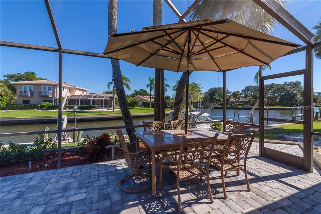 Outside dining area on lanai overlooking canal - Single Family Home for sale at 5439 Azure Way, Sarasota, FL 34242 - MLS Number is A4203969